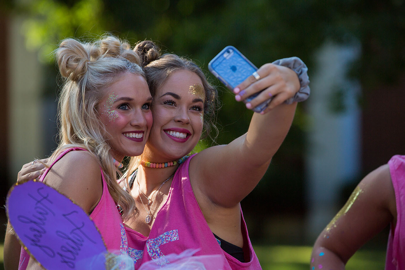 two new sorority members pose for the camera