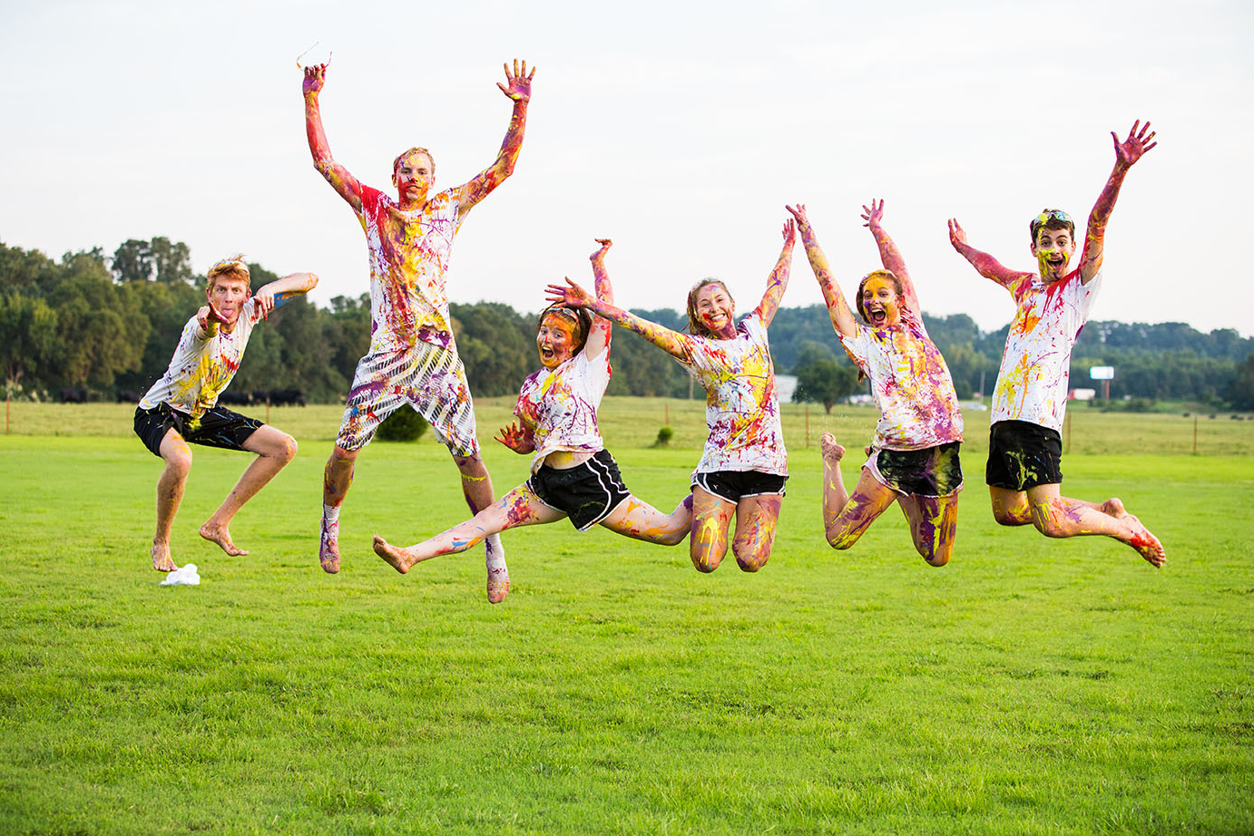 students jump for joy together after the SAB paint war